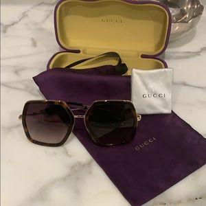 Women's Gucci sunglasses GG0106S gold tortoise